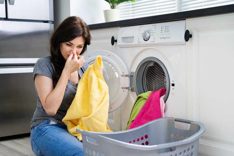 از بین بردن بوی بد لباسشویی